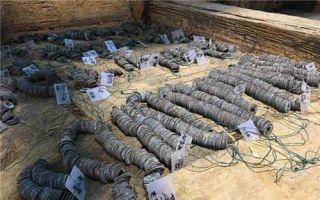 2000年前西汉古墓出土10余吨铜钱 揭秘墓葬主人身份