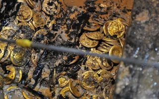 海昏侯墓出土金器纯度达99% 金饼金板属于酎金