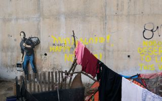难民营墙上的乔布斯肖像