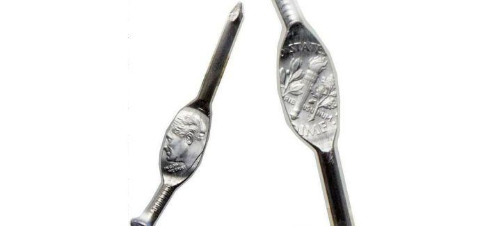美国一角硬币错印压扁钉子上 以27.6万元拍卖