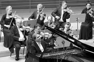 钢琴家布赫宾德:成名太早对音乐家是危险的