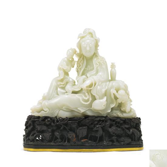 LOT 3776 于泾雕童子观音坐像成交价: 3220万元