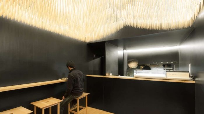 basho-sushi-bar-in-portugal-features-flying-chopsticks-on-ceiling-1-800x450
