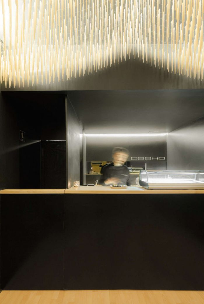 basho-sushi-bar-in-portugal-features-flying-chopsticks-on-ceiling-3-800x1192