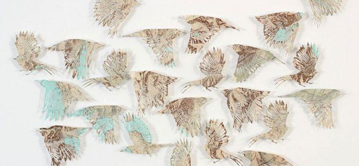 旧地图经精细切割后 这些似乎被赋予生命的鸟类剪影