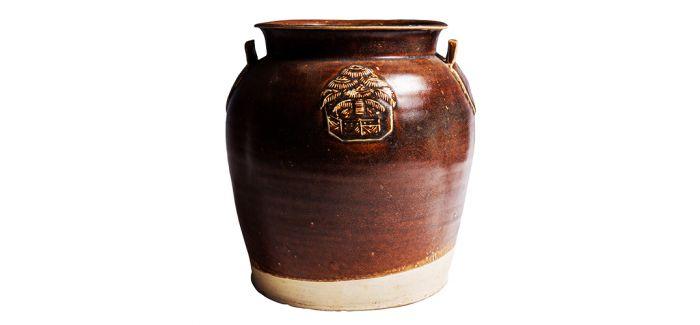 古朴致远!唐代长沙窑酱釉贴塑双系罐