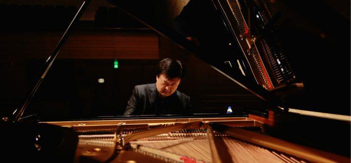 李坚带着音乐和童心行走中国