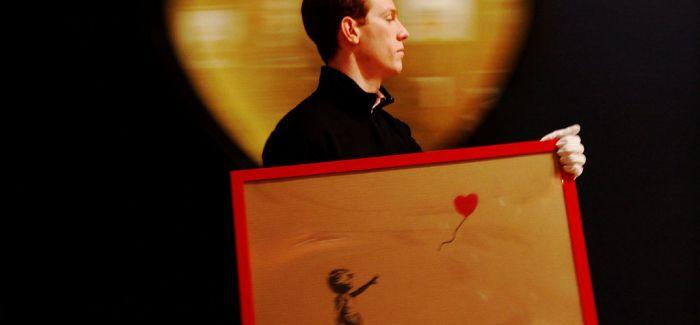 《女孩与气球》变身《垃圾桶中的爱》