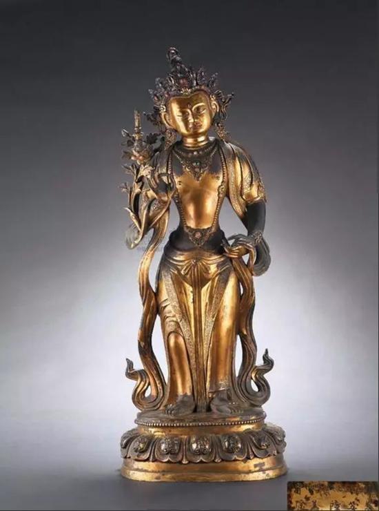 参阅:北京保利2011年春拍,LOT 7298,清乾隆 铜鎏金菩萨立像,高63厘米,成交价RMB 10,580,000。