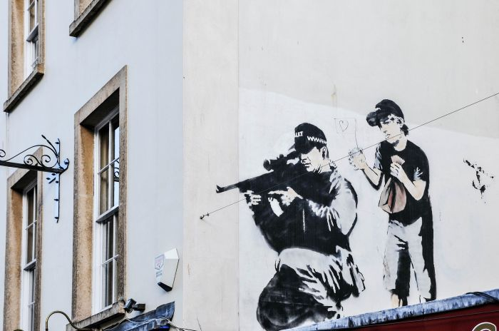 stencil-graffiti-piece-by-banksy-shutterstock_153204866-editorial-only-1000-words-2