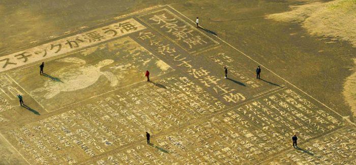 人们用大型沙雕艺术呼吁海洋环保